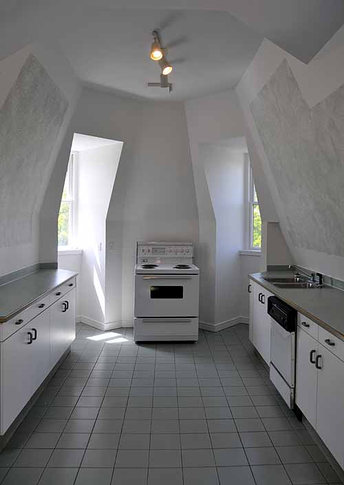 Second Empire mansard roof interior transformed into a modern kitchen.